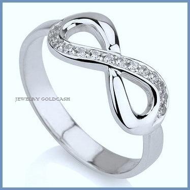 Infinito anillo de compromiso plata oro blanco envio for Precio rodiar anillo oro blanco