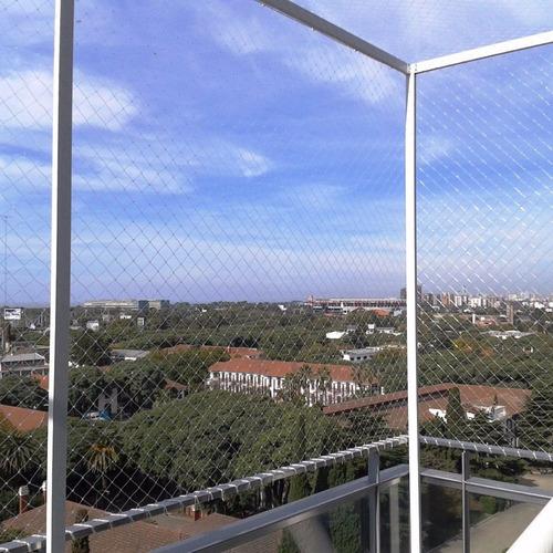 instalacion balcon seguridad proteccion ventana niño gato