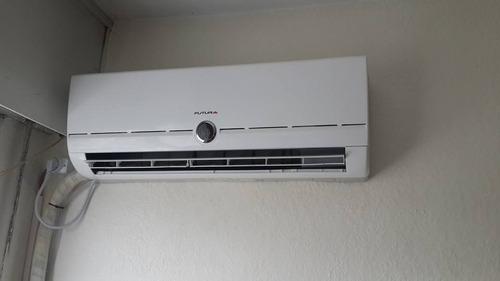 instalacion de aire acondicionado . reparacion . tecnico