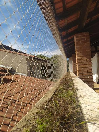 instalação de rede de proteção e tela mosquiteira