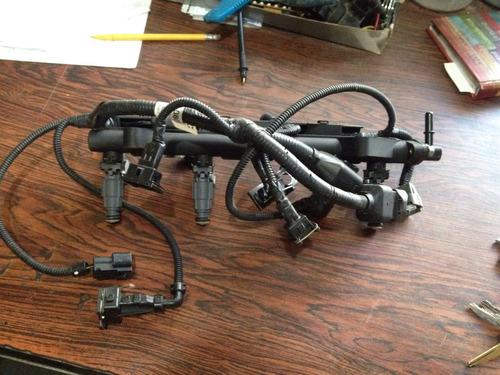 inyectores kia río stylus