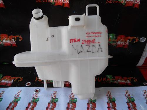 item 2719-15 deposito limpiadores mazda 3 original
