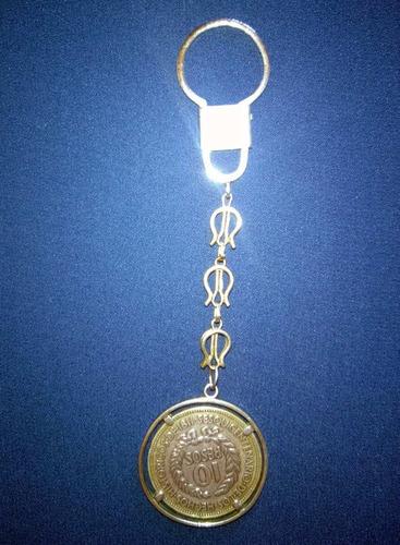 jc* moneda gaucho 1961 - en llavero de plata. 12,5 grs.