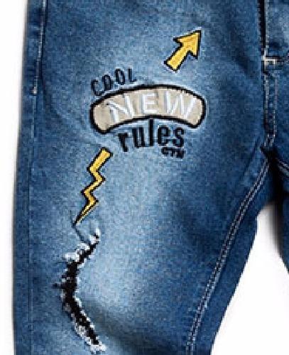 jean niño elastizado con rotura y parches bordados - santino