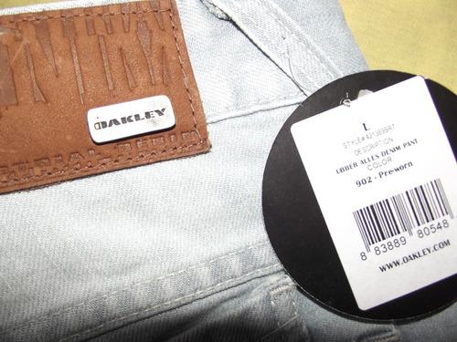 jeans oakley calças