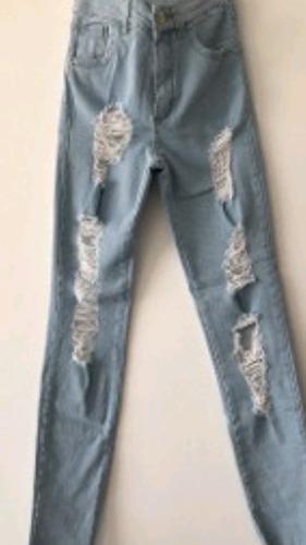 jeans semi elastizado tipo boyfriens roturas claro