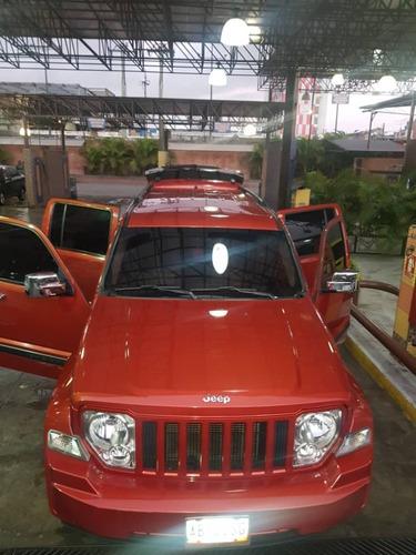 jeep cherokee sport wagon, año 2009, 5 puertas, naranja tent