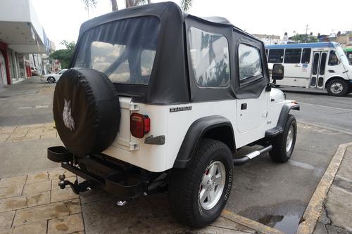 jeep wrangler 1990,exelente trato esta mejor que como se ve!