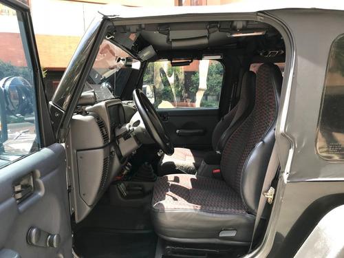 jeep wrangler: susp. rancho, bumpers warn, trailer y otros