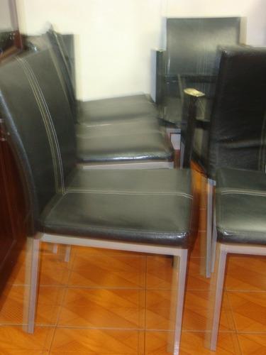juego de comedor 6 sillas en cuero.
