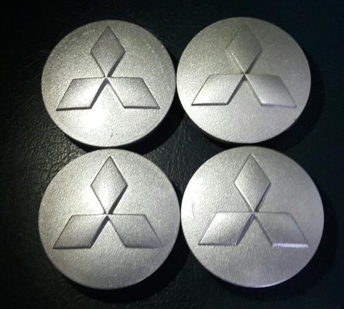 juego de tapas de aro originales mitsubishi