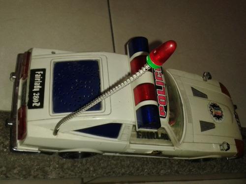 juguete auto patrulla, antigua marca datsun 1982