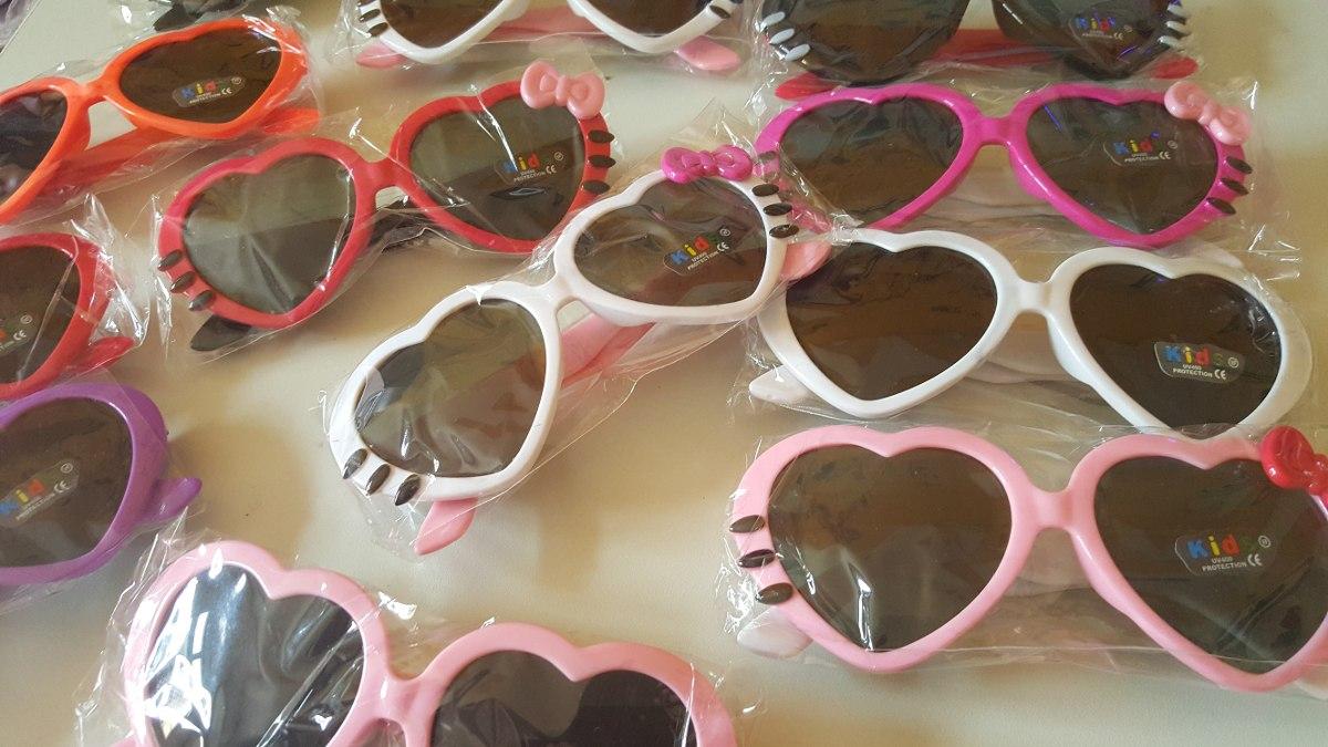 kit 10 óculos infantil sol modelo coração com laço atacado. Carregando zoom. e9838a0a59