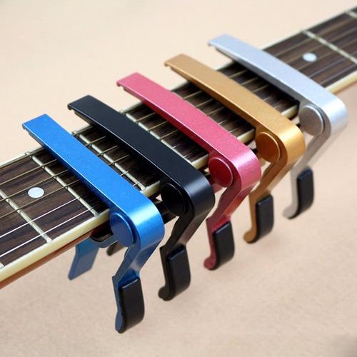 kit guitarrista, capo trasto, stand, limpia cuerdas, puas