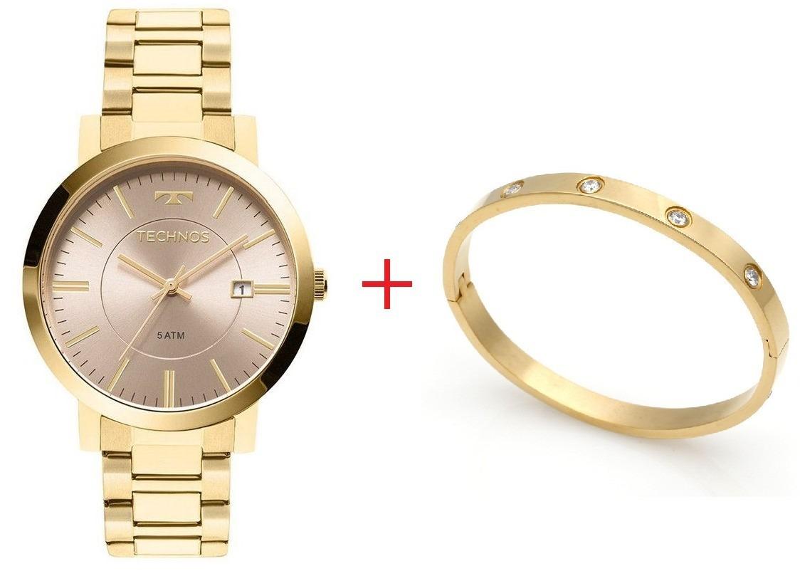 3dd9132ca11 kit relógio feminino dourado technos e bracelete de aço inox. Carregando  zoom.