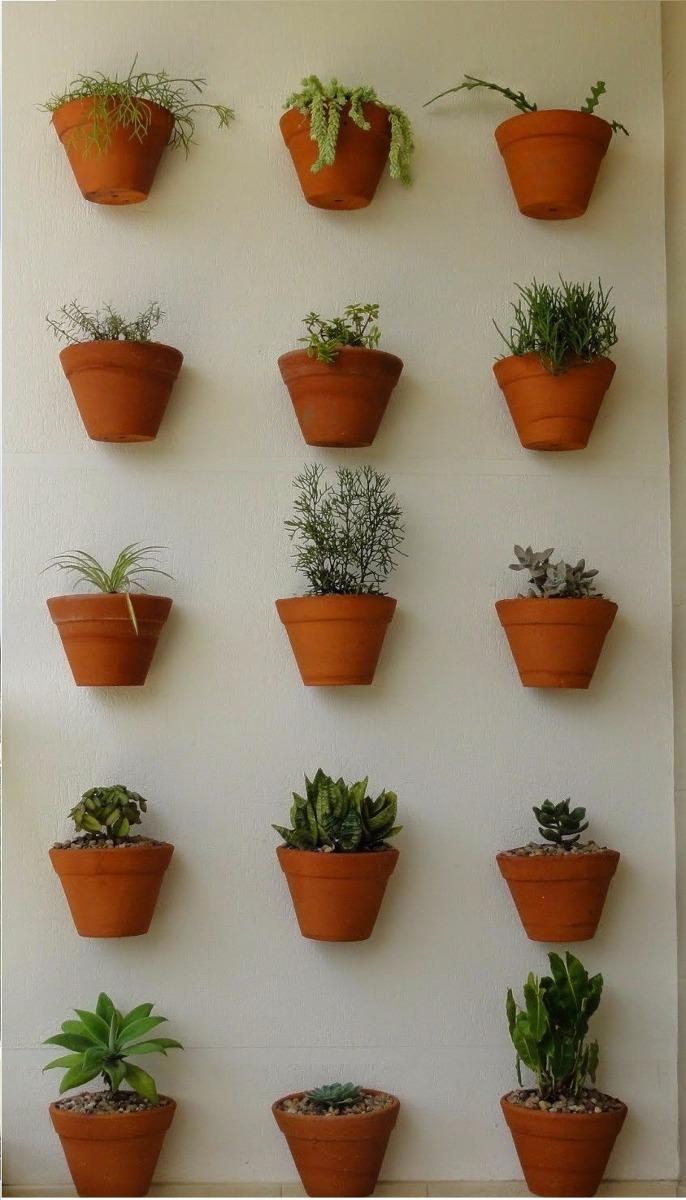 Resultado de imagem para jardim vertical Vasos individuais