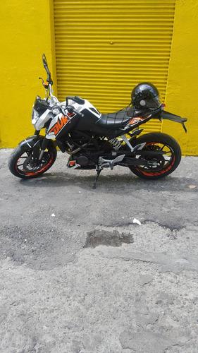 ktm 200 blanco con negro y naranja
