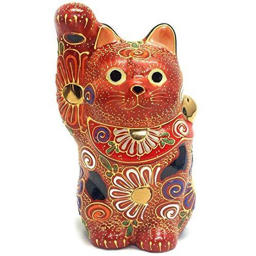 la mano derecha japonesa de maneki neko gato afortunado de