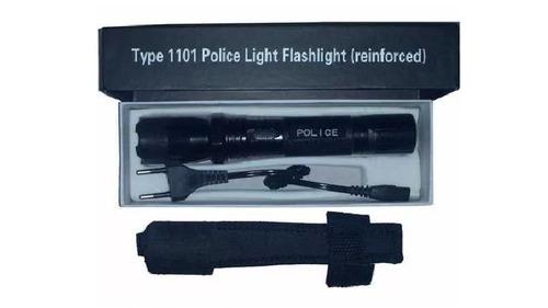 lanterna tatica  arma de choque taser