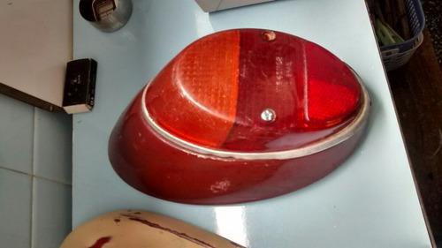 lanterna traseira fuscacom lente e aros origiais com logo vw