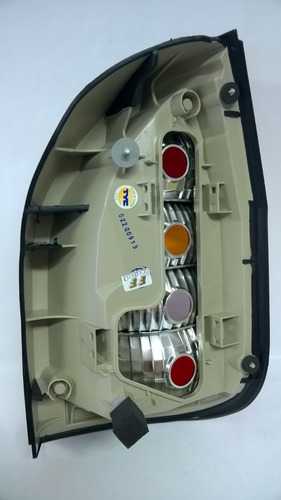 lanterna traseira zafira 99/ lado esquerdo tricolor tyc