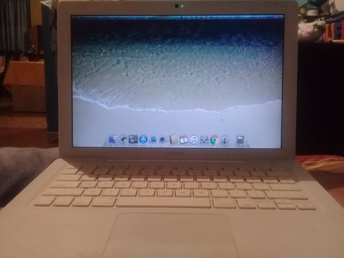 laptop macbook white by apple.