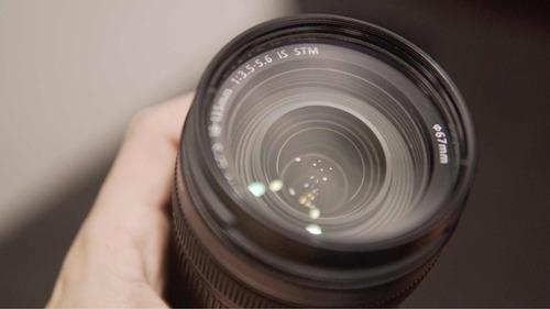 lente canon 18-135 más filtro y estuche.