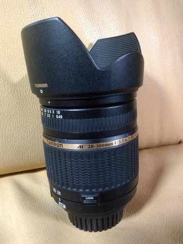 lente para nikon tamron af 28-300mm f/3.5 en 150 verdes