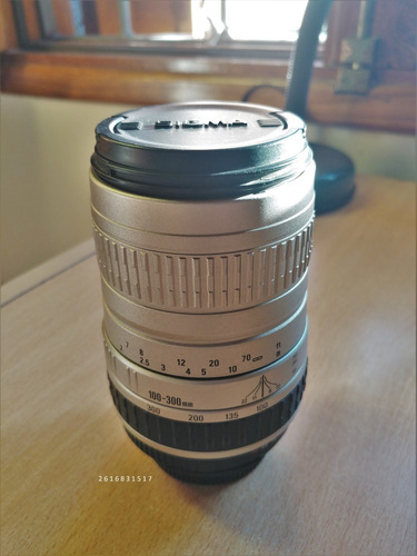 lente zoom sigma 100-300mm f4.5-6.7 dl montura nikon af-d