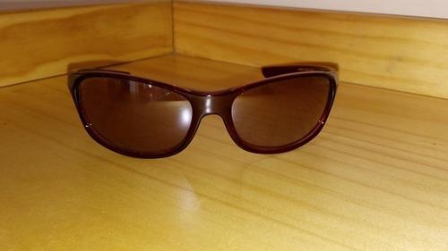 lentes de sol diseño italiano  color rojizo oferta