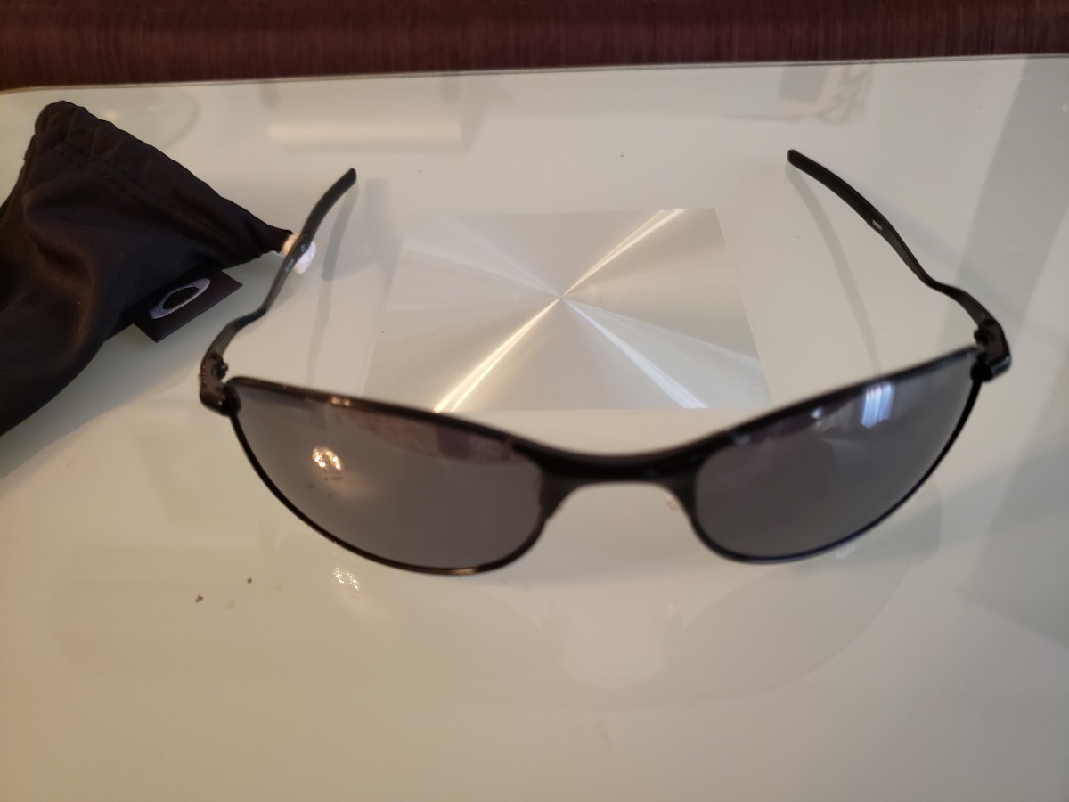 Lentes De Sol Oakley Tightrope Black Iridium Polarized 58-20 - Bs ... e905aa86ea27