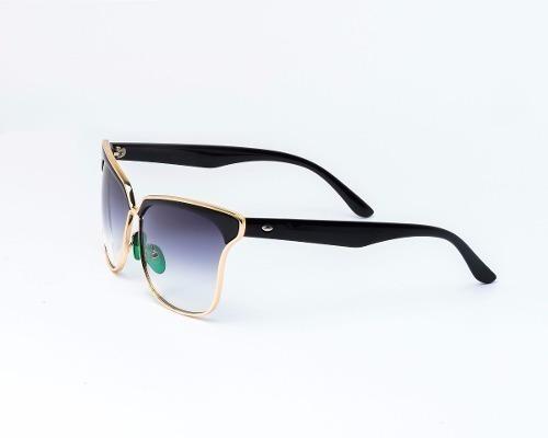 lentes de sol synergy negro/dorado 9779