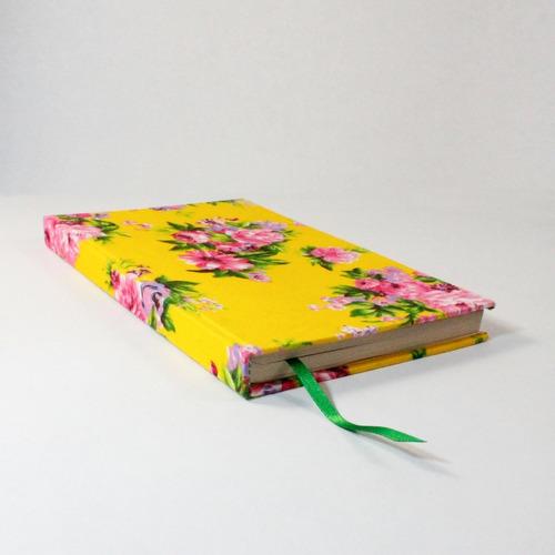 libreta-encuadernado artesanal, tapas duras, hojas lisas.