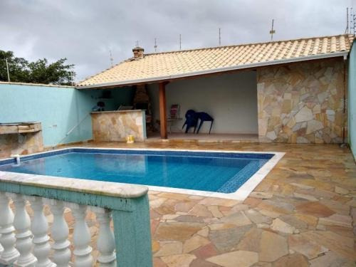 linda casa com piscina 3 dormitórios lado praia itanhaém sp