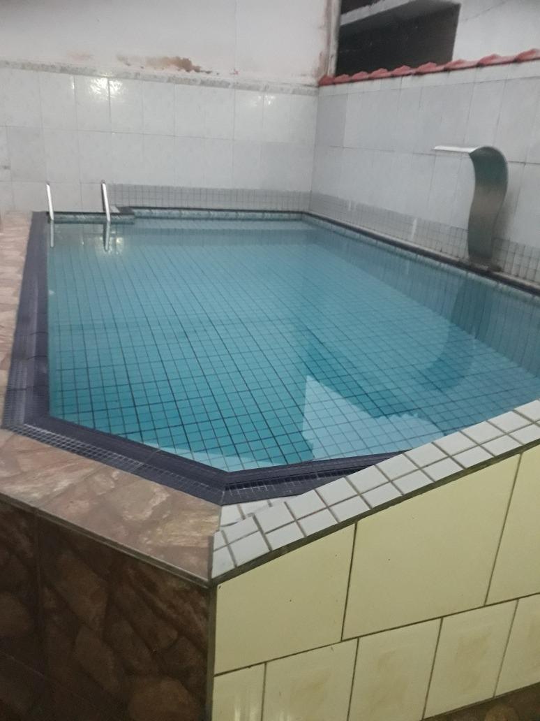 linda casa com piscina