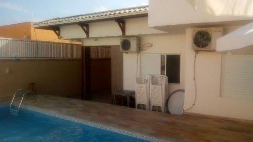 linda casa com piscina em itanhaém, bal tupy