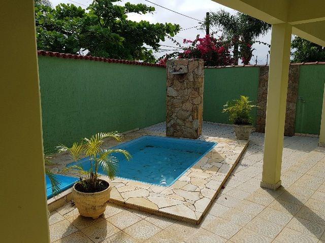 linda casa com piscina, no jardim diplomata, em itanhaém.