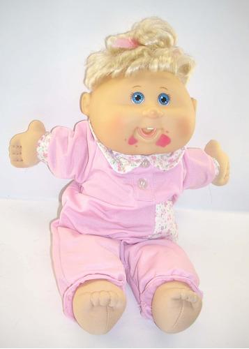 linda muñeca  cabbage 40 cms con traje rosado.
