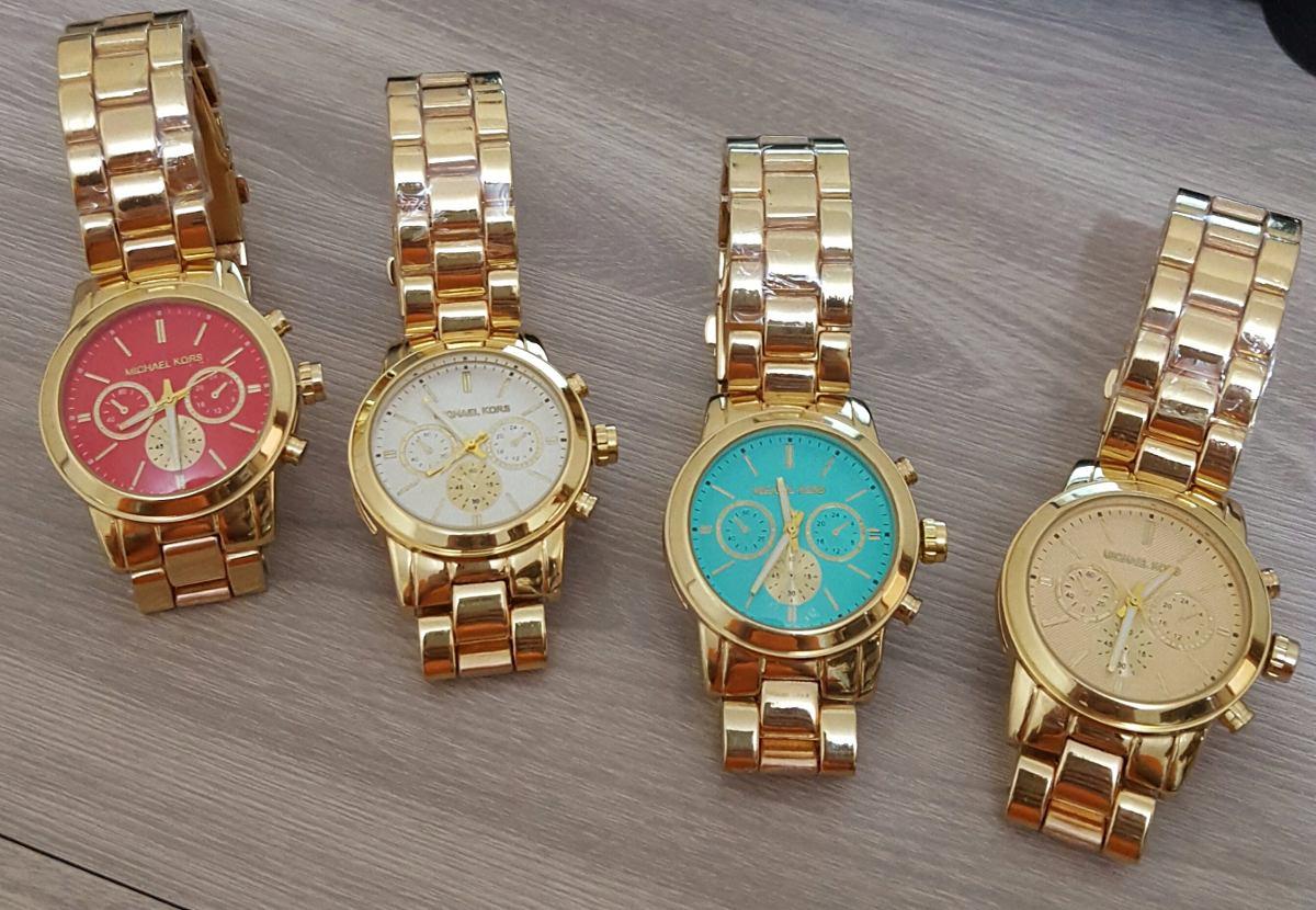 72b14021316 lindos relógios feminino versão michael kors em dourado. Carregando zoom.