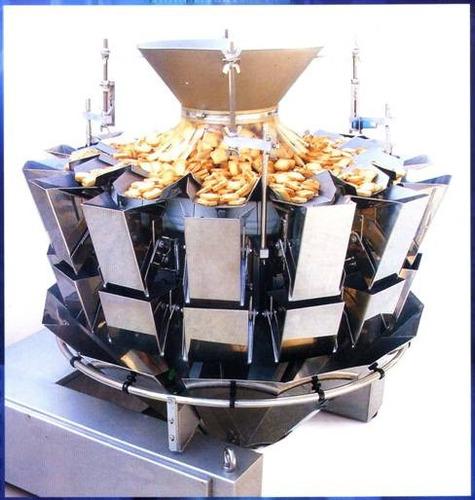 línea de envase de snacks con pesadora multicabezal