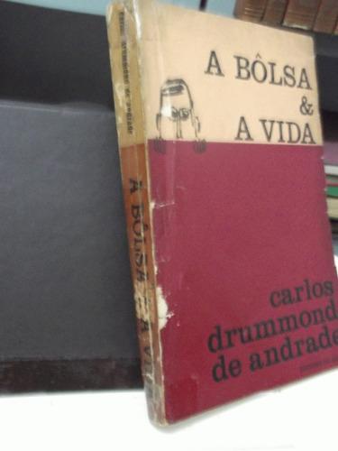 livro  a bôlsa & a vida carlos drummond de andrade 1º edição