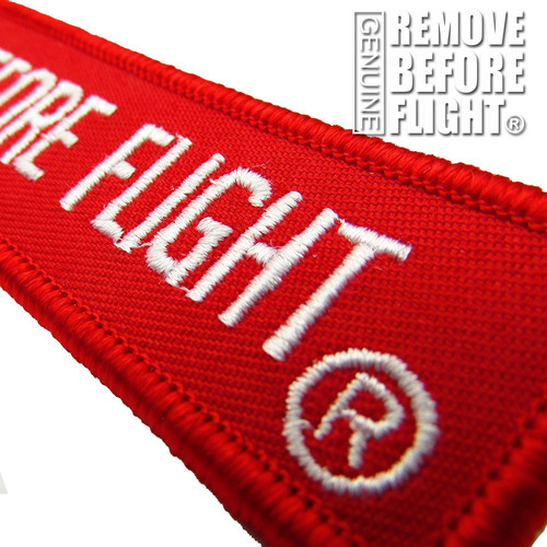 llavero  clásico color rojo remove before flight ®
