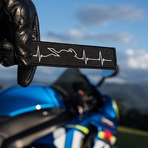 llavero  motociclismo remove before flight signo vital