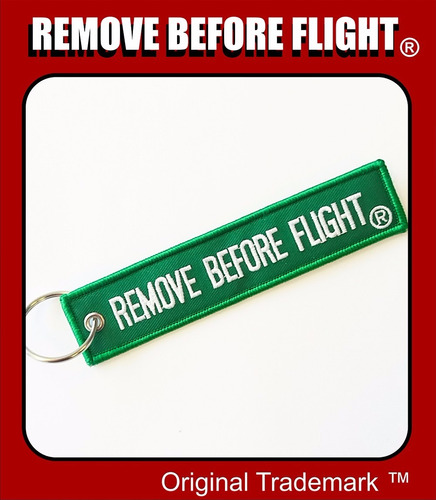 llavero  remove before flight verde con blanco