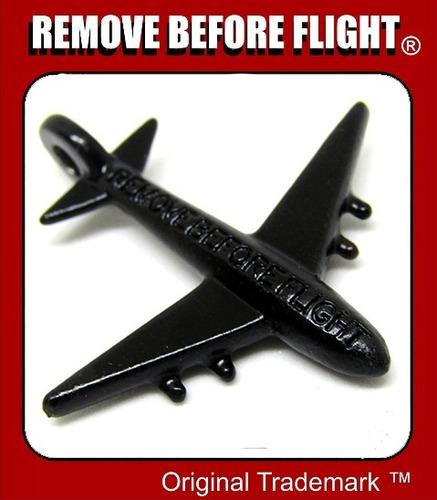 llavero y avión  remove before flight negro