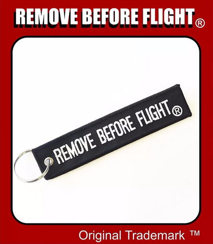 llavero y avión  remove before flight negro