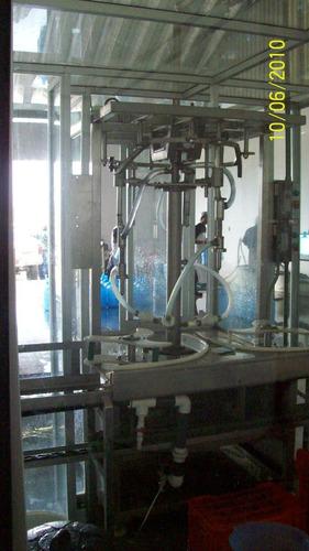 llenadora automática de garrafones en ac. inox. 130000 neto