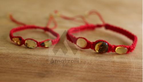 lote 12 pulseras artesanales de ámbar tejido con hilo rojo