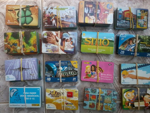lote com 600 cartoes telefonicos sem repetidos + 1 catálogo