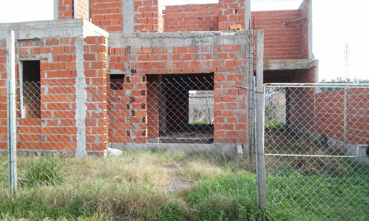 lote con casa en construcción-excelente oportunidad